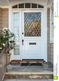 White Front Door White Front Door Of Upscale Beige Home Stock Photography Image