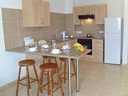 Small Kitchen Design In Minimalist Style With Breakfast Bar From - Simple kitchen planner