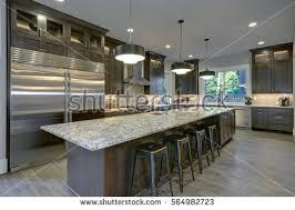Bar Stool Kitchen Island Modern Kitchen Brown Kitchen Cabinets Oversized Stock Photo