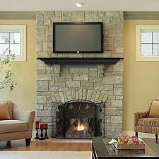 fireplace room with stone fireplace decorating ideas stacked tv