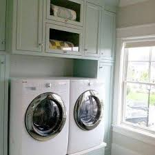 Laundry Room Storage Cabinets Ideas - laundry room storage cabinets in narrow small space with black
