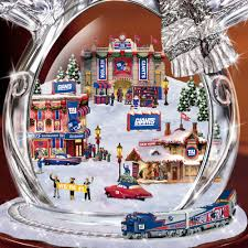 the new york giants crystal snowman with moving train hammacher