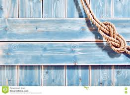 rope figure eight knot on blue wood stock photo