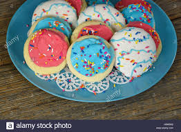 frosting on sugar cookies with sprinkles stock photo royalty free