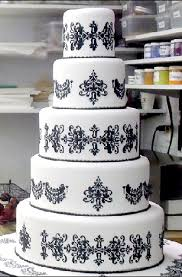 black lace piping on white fondant but ivory instead of white