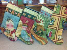 christmas stockings made out of quilting fabric fabric by nancy