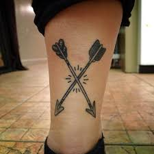 cool boy leg decorated with fantastic cross small arrow tattoo