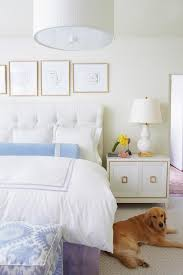 white bedroom with blue and purple accents transitional bedroom