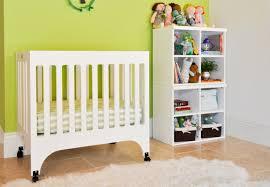 Portable Crib Mattress Size by Mini Crib With Storage Undernea Bayb