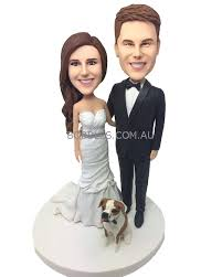 woman cake topper and dog wedding cake topper