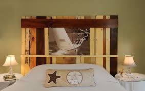 custom diy unsual high headboard made from reclaimed wood and