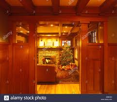 craftsman home doorway into living room interior with christmas