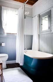 bathroom with freestanding tub and grey beadboard wainscoting