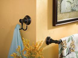 Bathroom Towel Design Ideas by Cheerful Bathroom Design With Black Metal Towel Hook And Orange