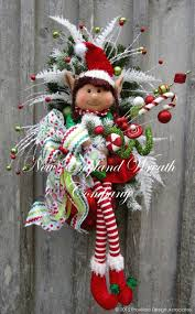 christmas elf wreath with hanging legs and hand painted north pole