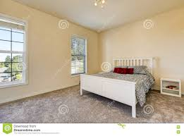 White Bedroom Grey Carpet Simple Upstairs Bedroom With Soft Peach Walls Gray Carpet Stock