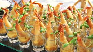 people grab appetizers cocktail party catering buffet catering