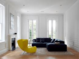 interior minimalist design with yellow chaise lounge and black