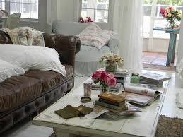 shabby chic living room with brown leather couch carameloffers
