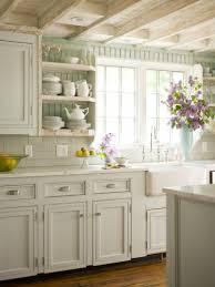 milk white kitchen cabinetry light white subway tile backsplash