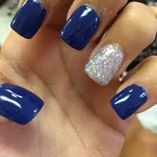 royal blue acrylic nails with silver hair makeup and nails