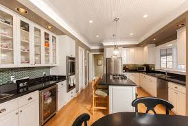 is it better to refinish or replace kitchen cabinets refinishing cabinets vs replacing get your kitchen