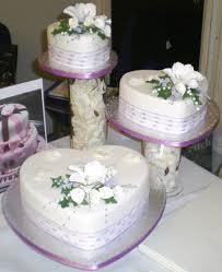 heart wedding cake shaped wedding cakes with white flowers
