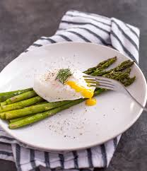 cuisine made in roasted asparagus with poached eggs ahead of thyme