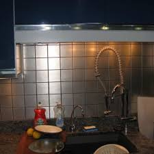amusing silver color stainless steel kitchen backsplash featuring