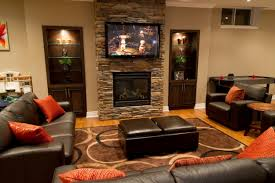 Decorations Tv Over Fireplace Ideas by Decor Tv Over Fireplace And Shelves With Ottoman Also Sectional