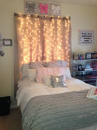 lights to hang in room love the way the lights hang over the bed this is literally sarah s