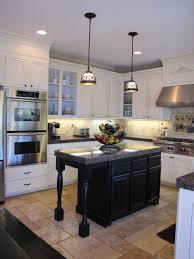 cabinets dark wooden kitchen island pendant light oven marble
