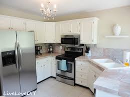 Backsplash With White Kitchen Cabinets by White Kitchen Cabinets With Gray Granite Countertop