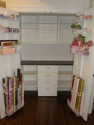 Closet Craft Room - wrapping paper storage spaces eclectic with craft room cubbies