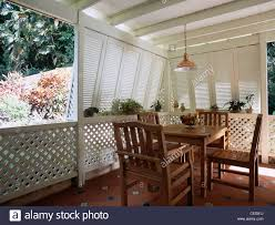 Simple Wooden Chair And Table Simple Wood Dining Table And Chairs In Corner Of Caribbean Veranda