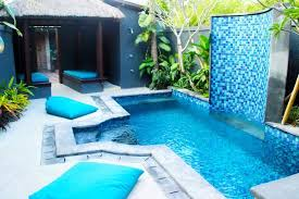swimming pool with waterfall bean bags and gazebo picture of