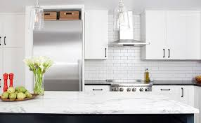 kitchen delicate ceramic tile backsplash and white wood cabinet