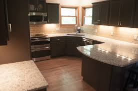 Dark Oak Laminate Flooring Dark Brown Wooden Kitchen Cabinets Having Grey Marble Countertop