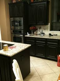 Kitchen Oak Restaining Cabinets With Daltile Backsplash And Black - Daltile backsplash