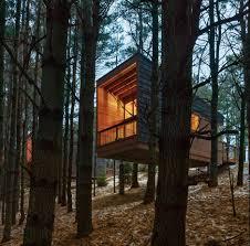 hga perches cedar clad cabins on a minnesota hillside minnesota