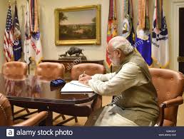 india prime minister narendra modi signs the guest book before his