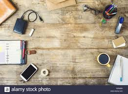 Desk Supplies For Office Mix Of Office Supplies And Gadgets On A Wooden Desk Background
