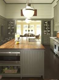 Green Kitchens Ge Profile Kitchen With Black Appliances Green Walls And White