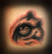 a picture titled tiger eye ripping out of skin tattoos