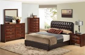traditional brown bedroom set with brown upholstered bed