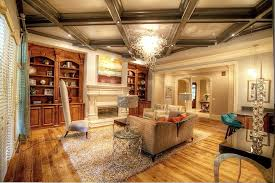 traditional living room with crown molding by atlanta sold sisters