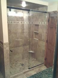 bathroom frameless shower doors wih black handle plus tan wall