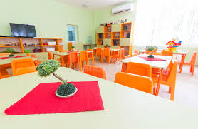 kindergarten classroom with small chairs and tables stock image