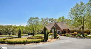 homes for sale with a one acre lot in greenville