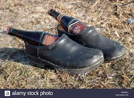 a pair of wooden shoes with each a bottle of royal beer wait for